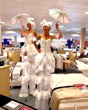 Stilts walkers white UV costumes